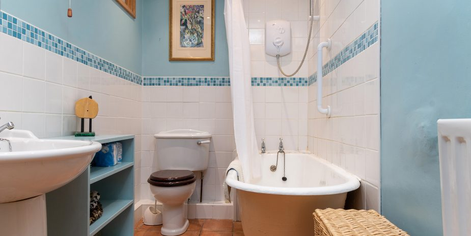 Family bathroom with electric shower over
