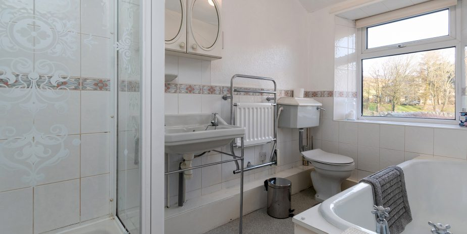 Bathroom with separate electric shower
