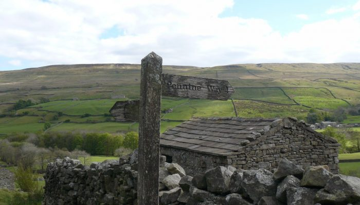 wooden sign to pennine way