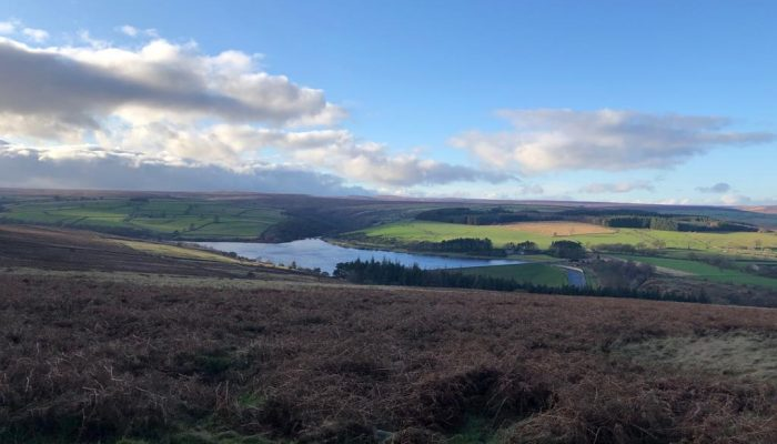 A view of a reservoir with clouds in the sky